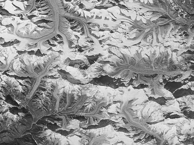 A black-and-white aerial photograph of a snowy landscape.
