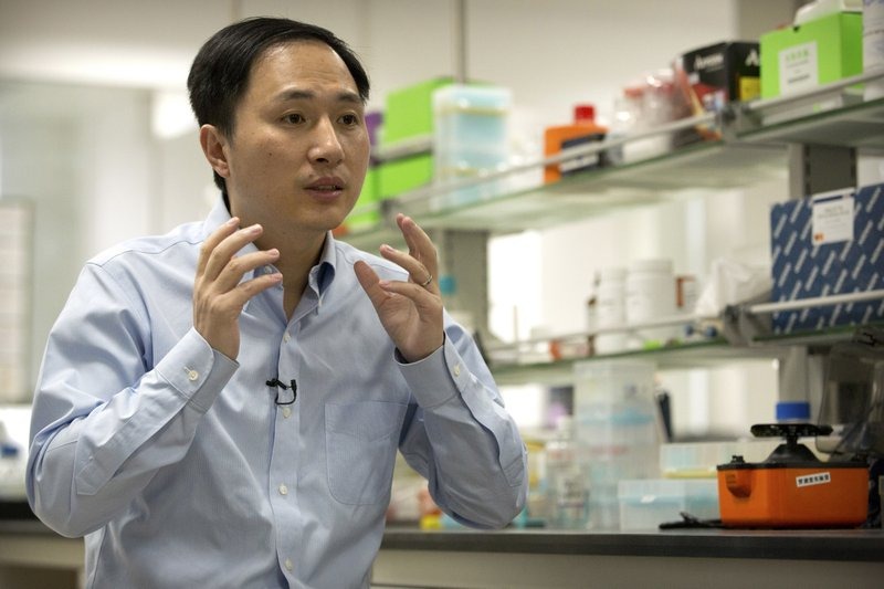 Asian man speaking in a laboratory.